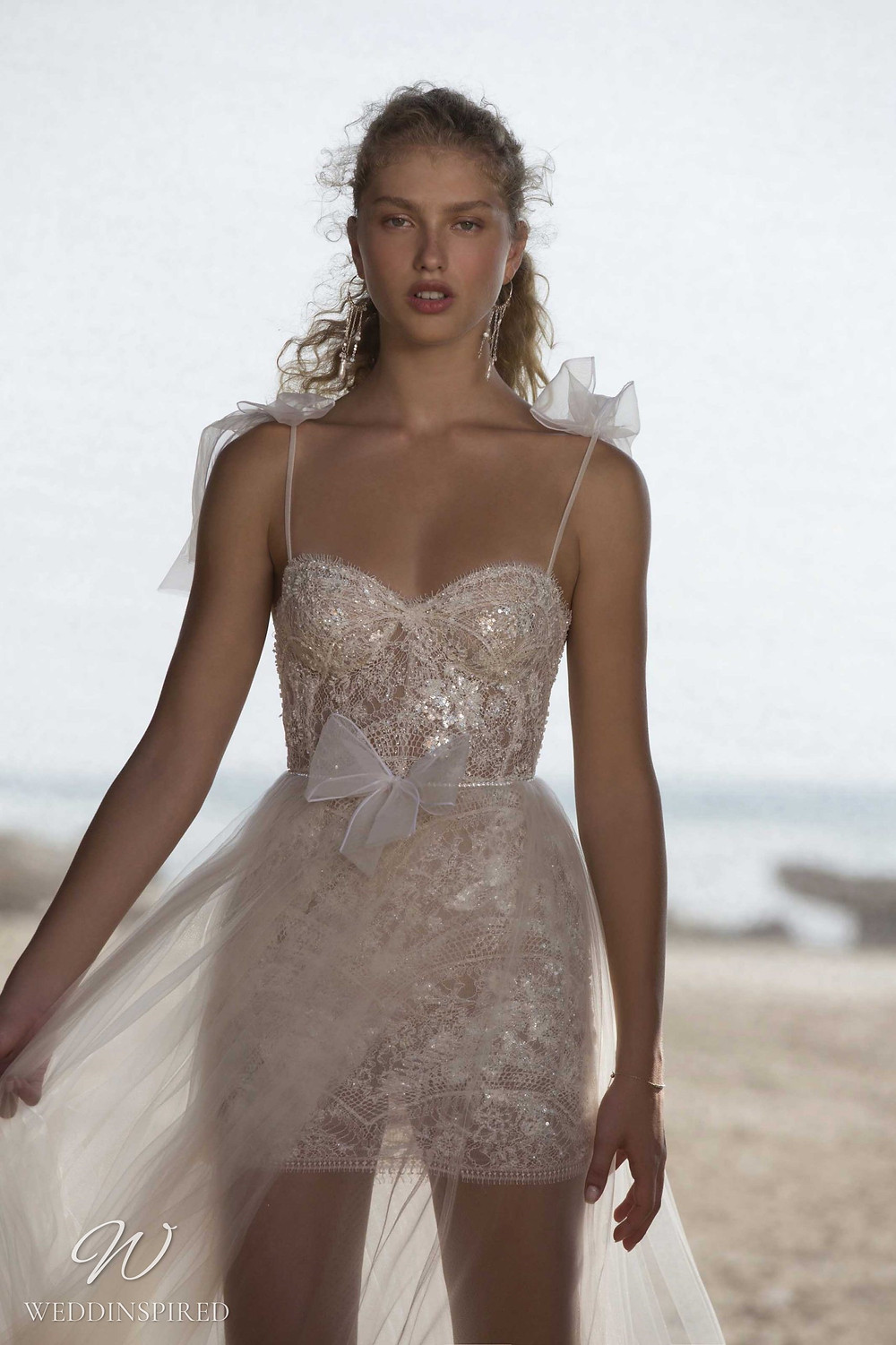 A Muse by Berta ivory tulle and lace short wedding dress with a detachable skirt and straps