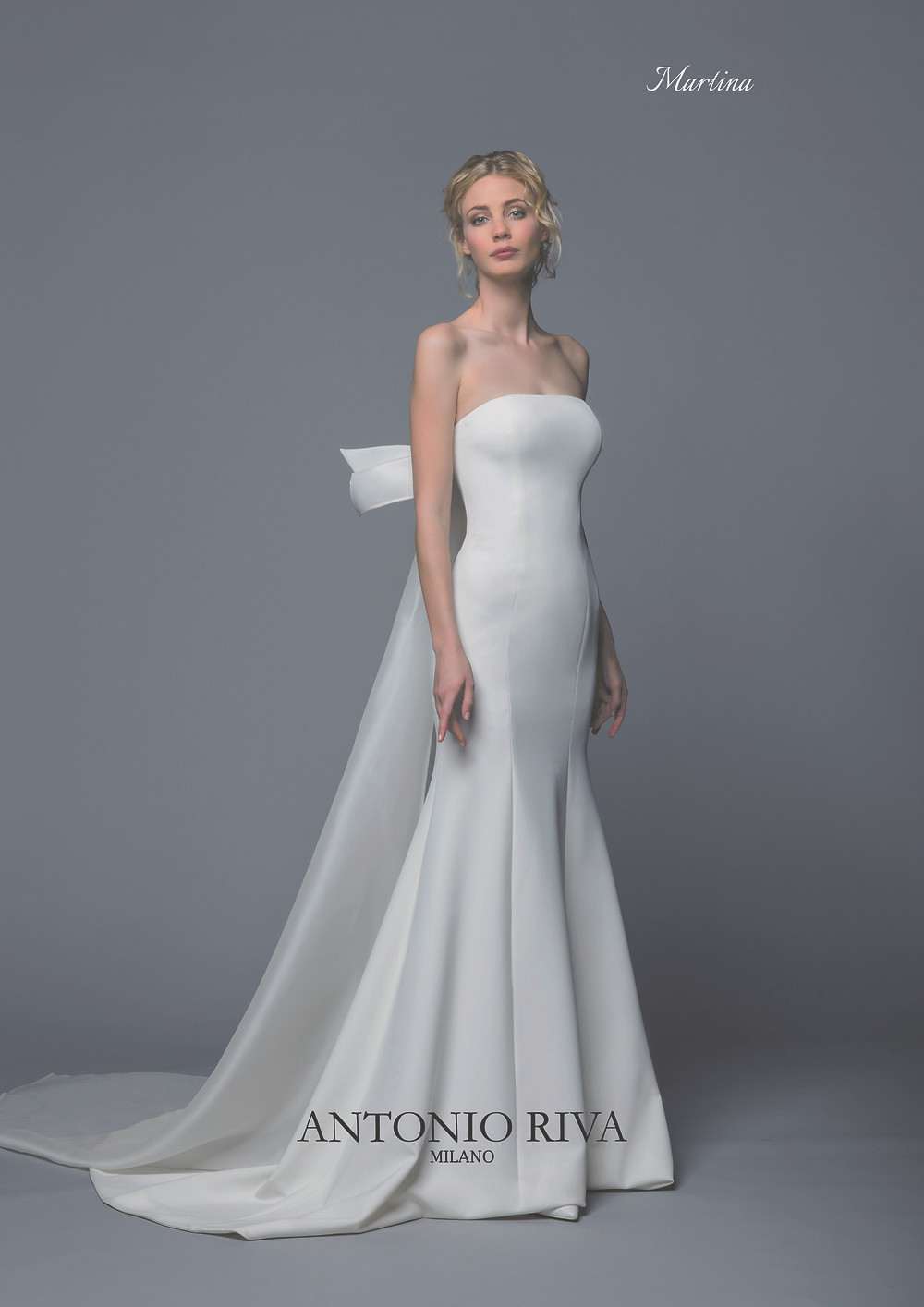An Antonio Riva 2020 simple strapless crepe mermaid fit and flare wedding dress with a train