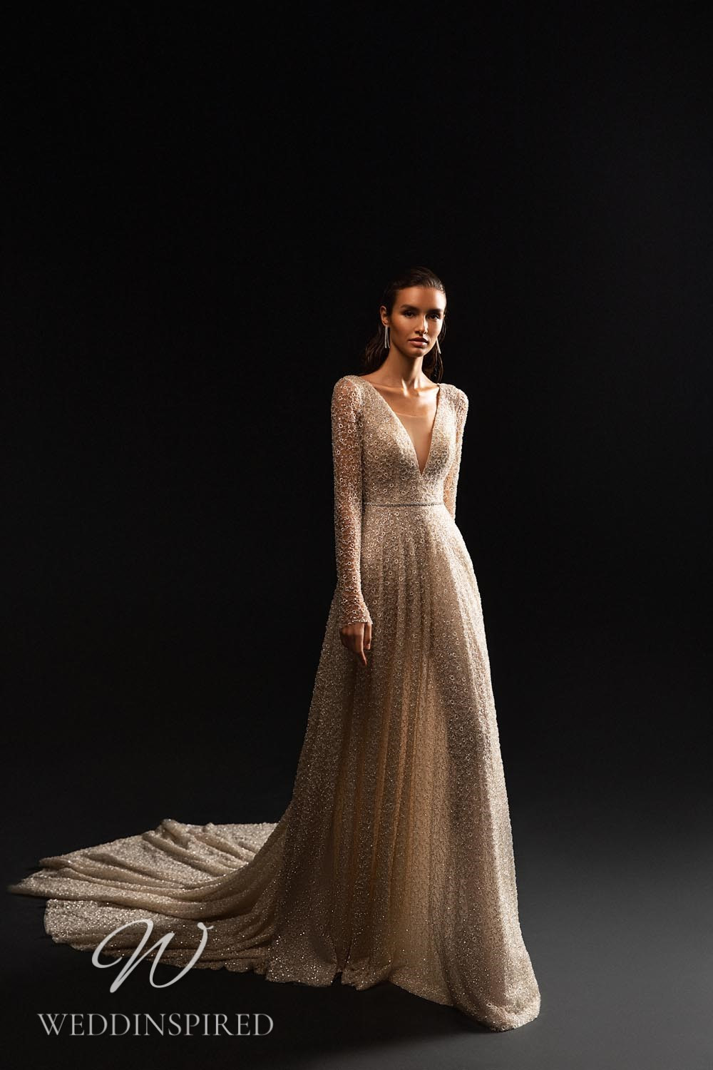 A WONÁ Concept 2021 sparkly champagne A-line wedding dress with long sleeves