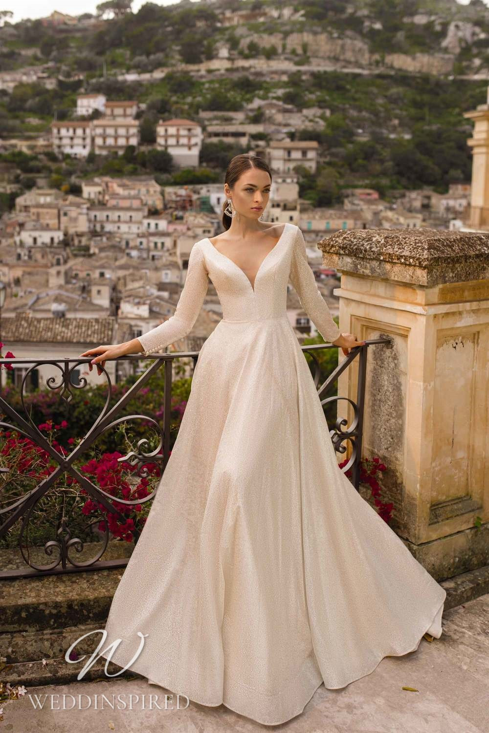 A Lussano 2021 sparkly champagne A-line wedding dress with long sleeves