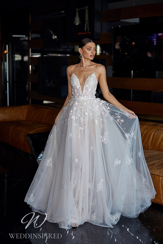 An Ida Torez 2021 flowy lace and tulle A-line wedding dress