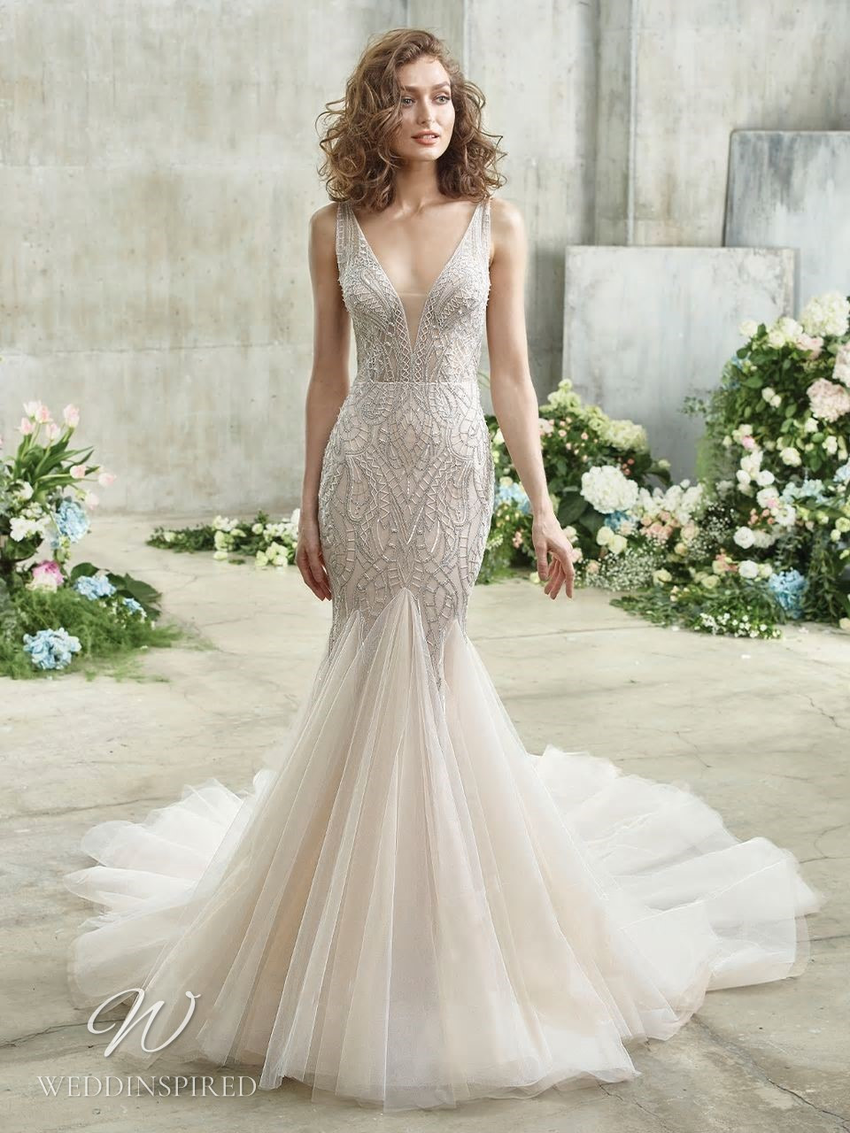 A Badgley Mischka gauzy blush mermaid wedding dress with a tulle skirt, beading and a v neckline