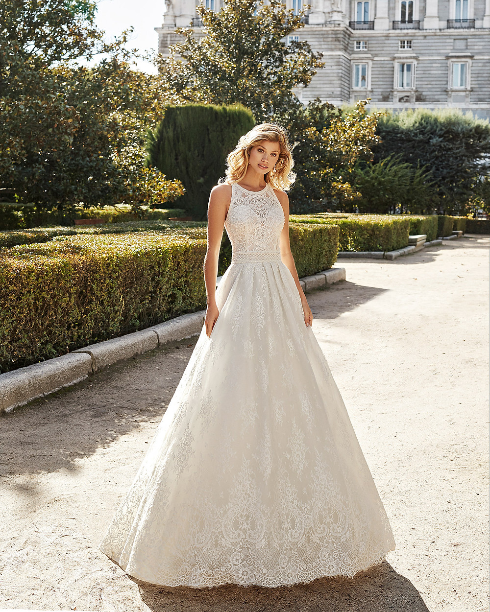 An Aire Barcelona 2020 lace A-line wedding dress with a high neckline