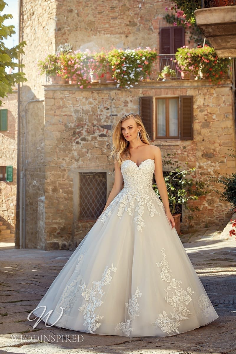 An Eddy K 2021 lace and tulle ball gown wedding dress
