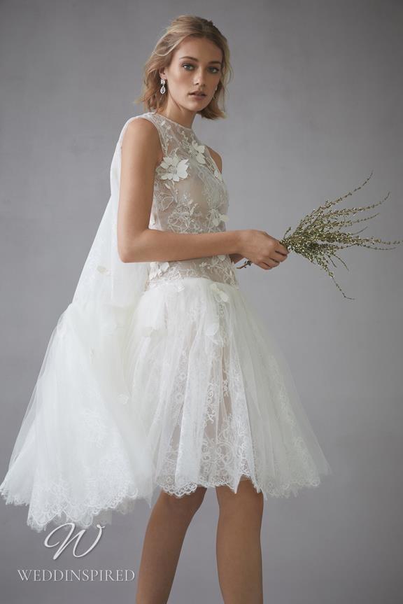 An Oscar de la Renta 2022 short lace wedding dress