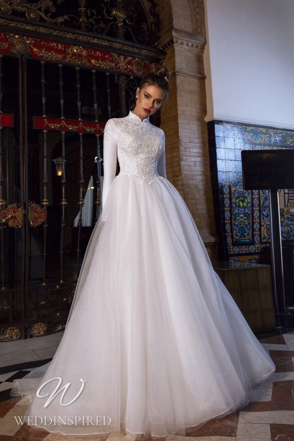 A Maks Mariano modest lace and tulle princess wedding dress with long sleeves