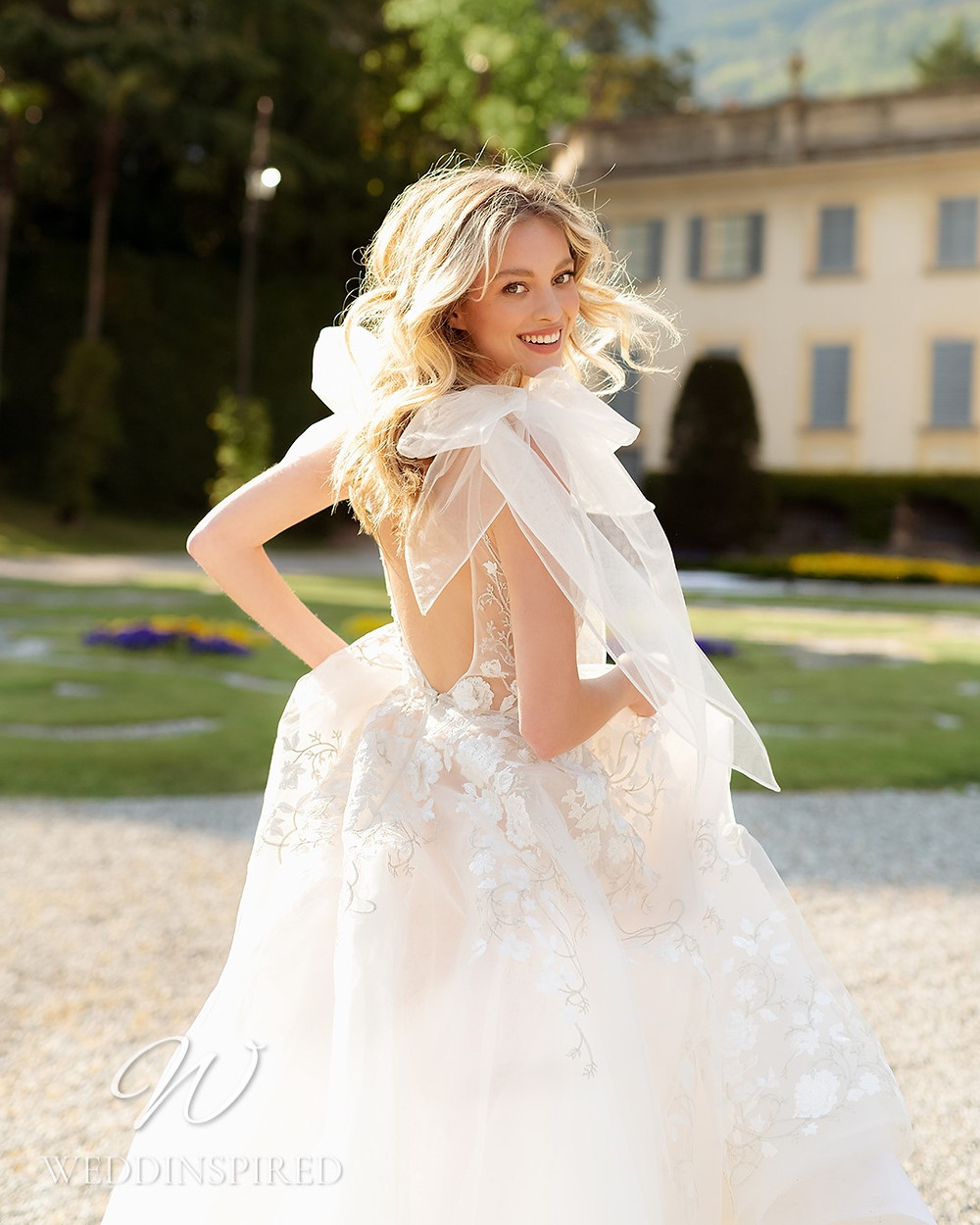 A Berta 2022 flowy tulle A-line wedding dress with a v neck
