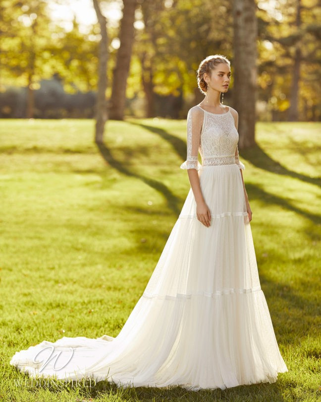 An Aire Barcelona 2021 lace and tulle A-line wedding dress with half sleeves
