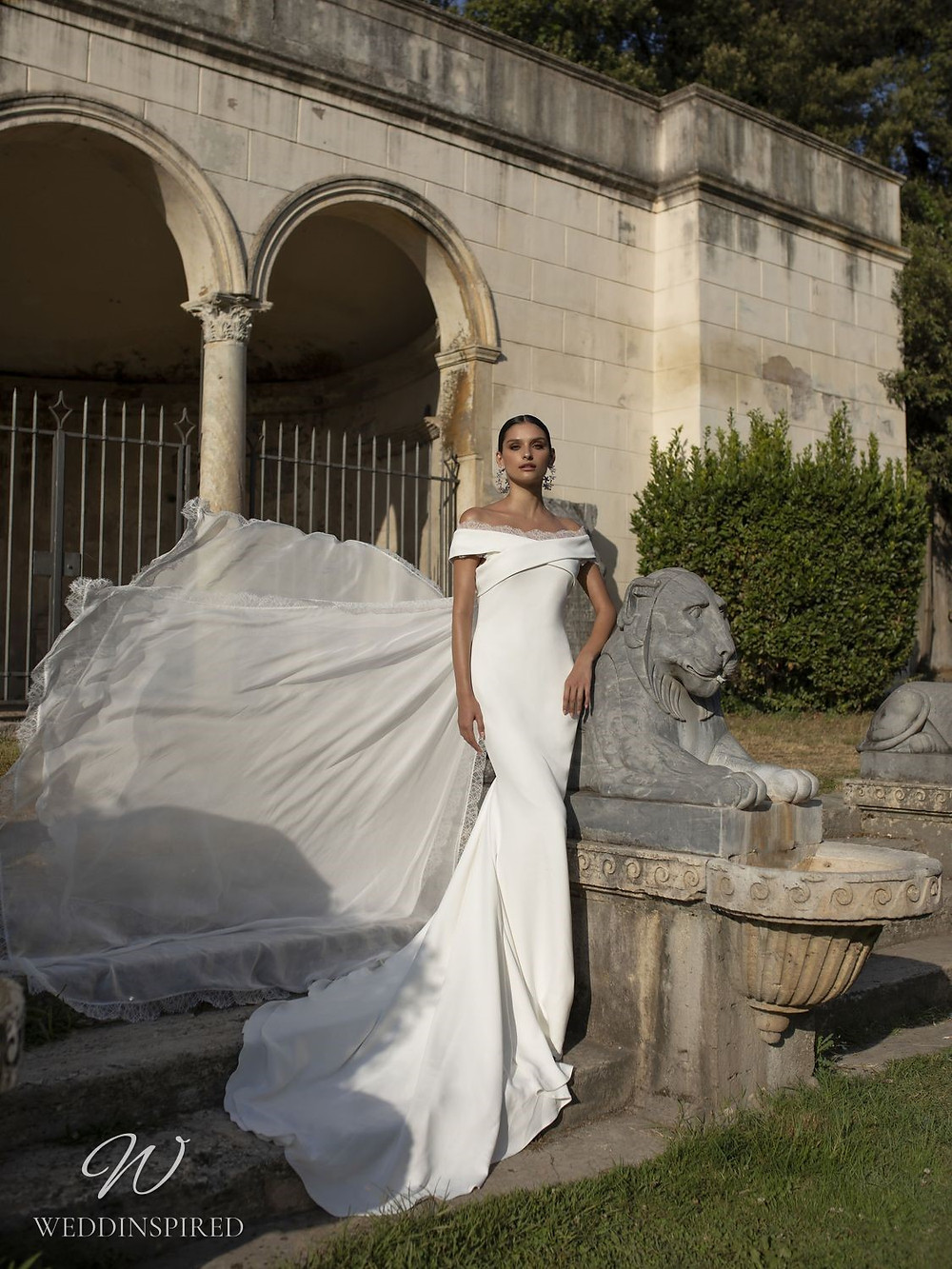 A Pinella Passaro off the shoulder mermaid wedding dress with a veil