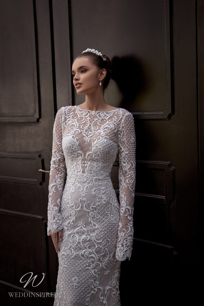 A Julie Vino 2021 lace mermaid wedding dress with long sleeves and a high neckline