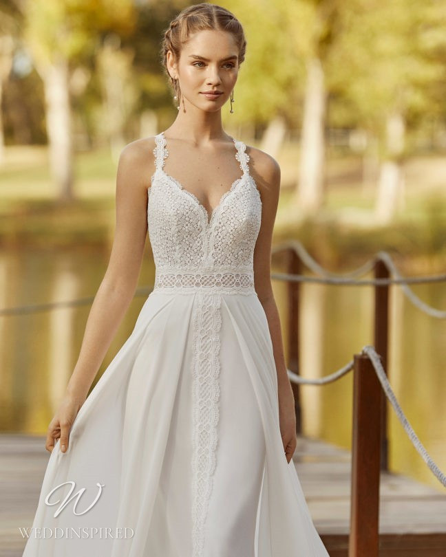 An Aire Barcelona 2021 flowy lace mermaid wedding dress with a v neck