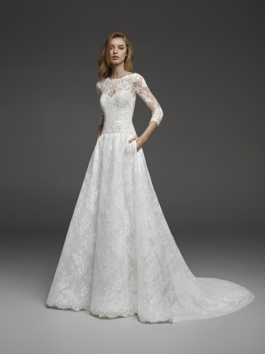 A Pronovias romantic lace A-line wedding dress with pockets and half sleeves