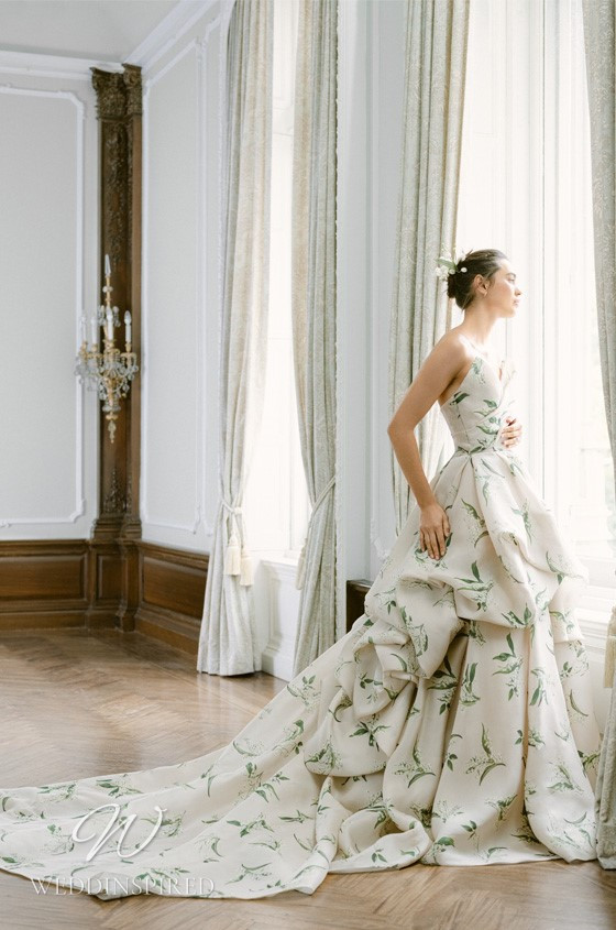 A Monique Lhuillier Fall 2021 strapless ball gown wedding dress with leaf print and a layered skirt