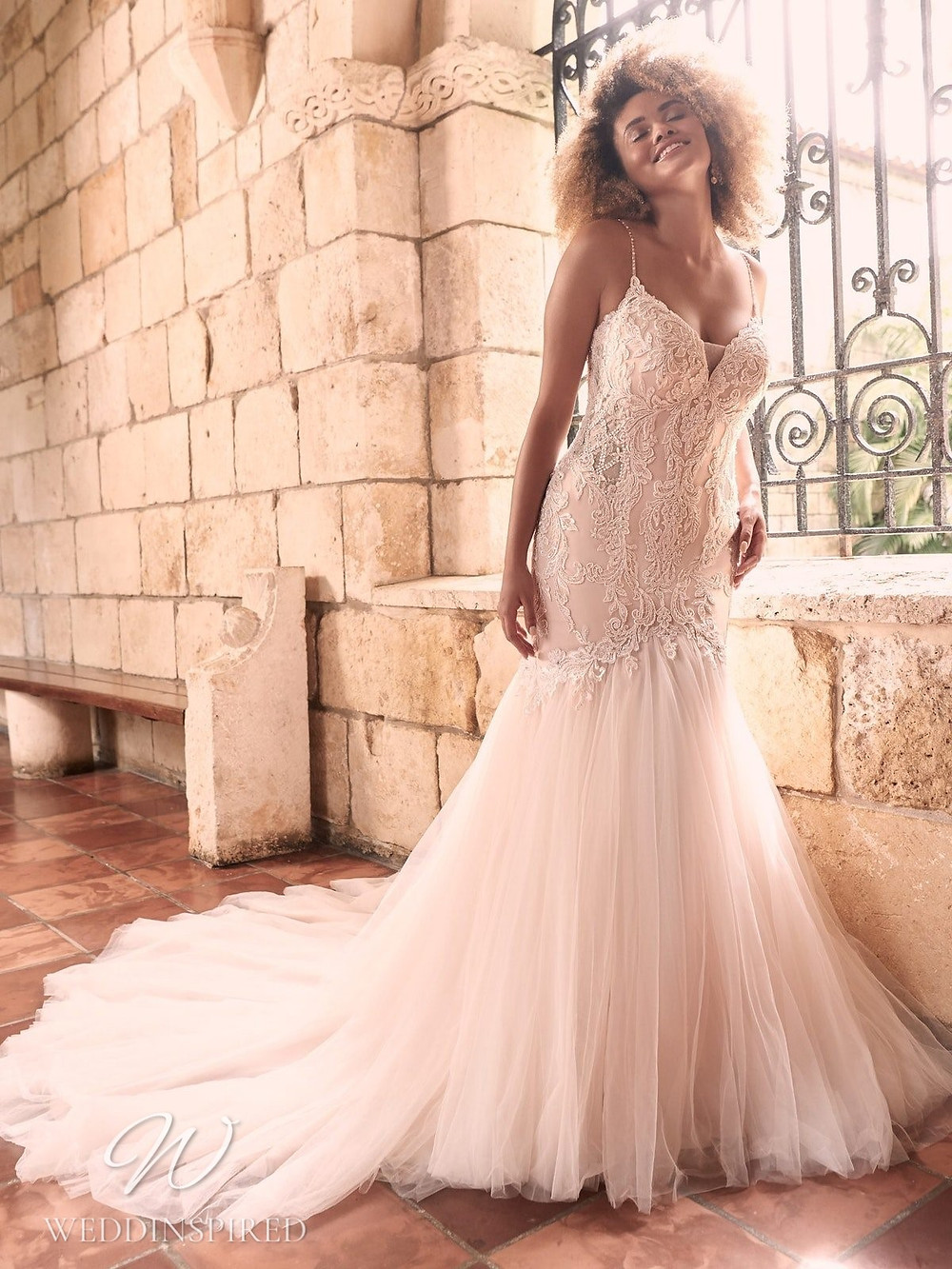 A Maggie Sottero Spring 2021 blush lace mermaid wedding dress with straps and a v neck