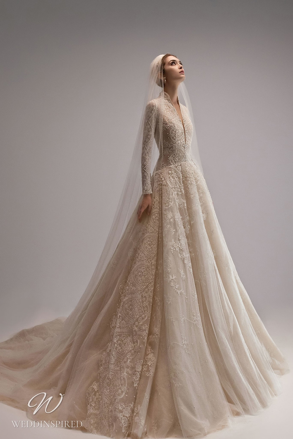 An Ersa Atelier 2021 ball gown wedding dress with a tulle skirt, long sleeves and beading