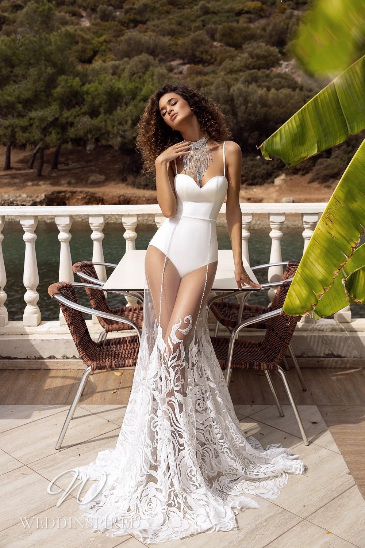 A Tina Valerdi satin and lace mermaid wedding dress