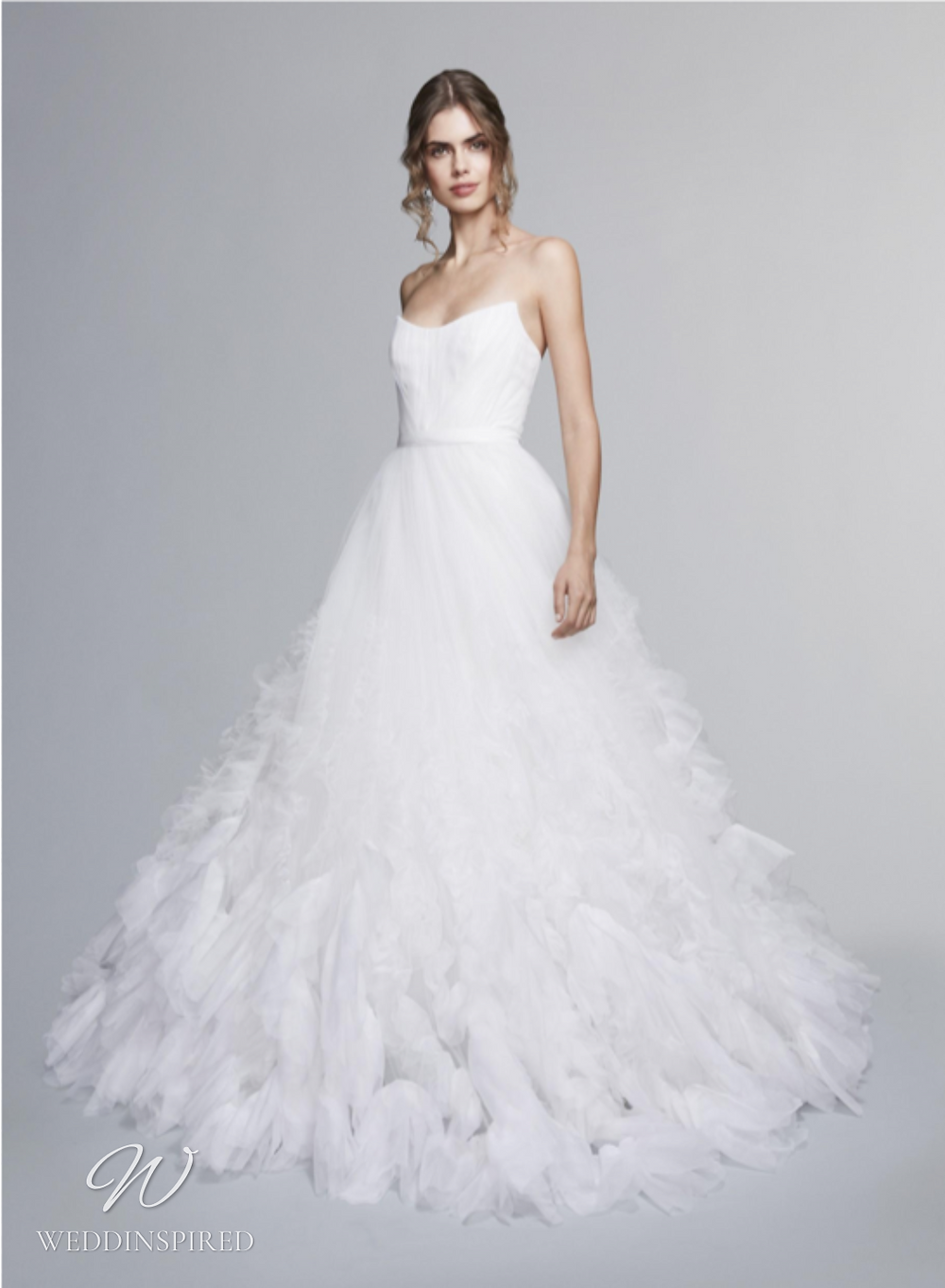 A Marchesa Notte Fall 2021 strapless tulle ball gown wedding dress with a ruffle skirt