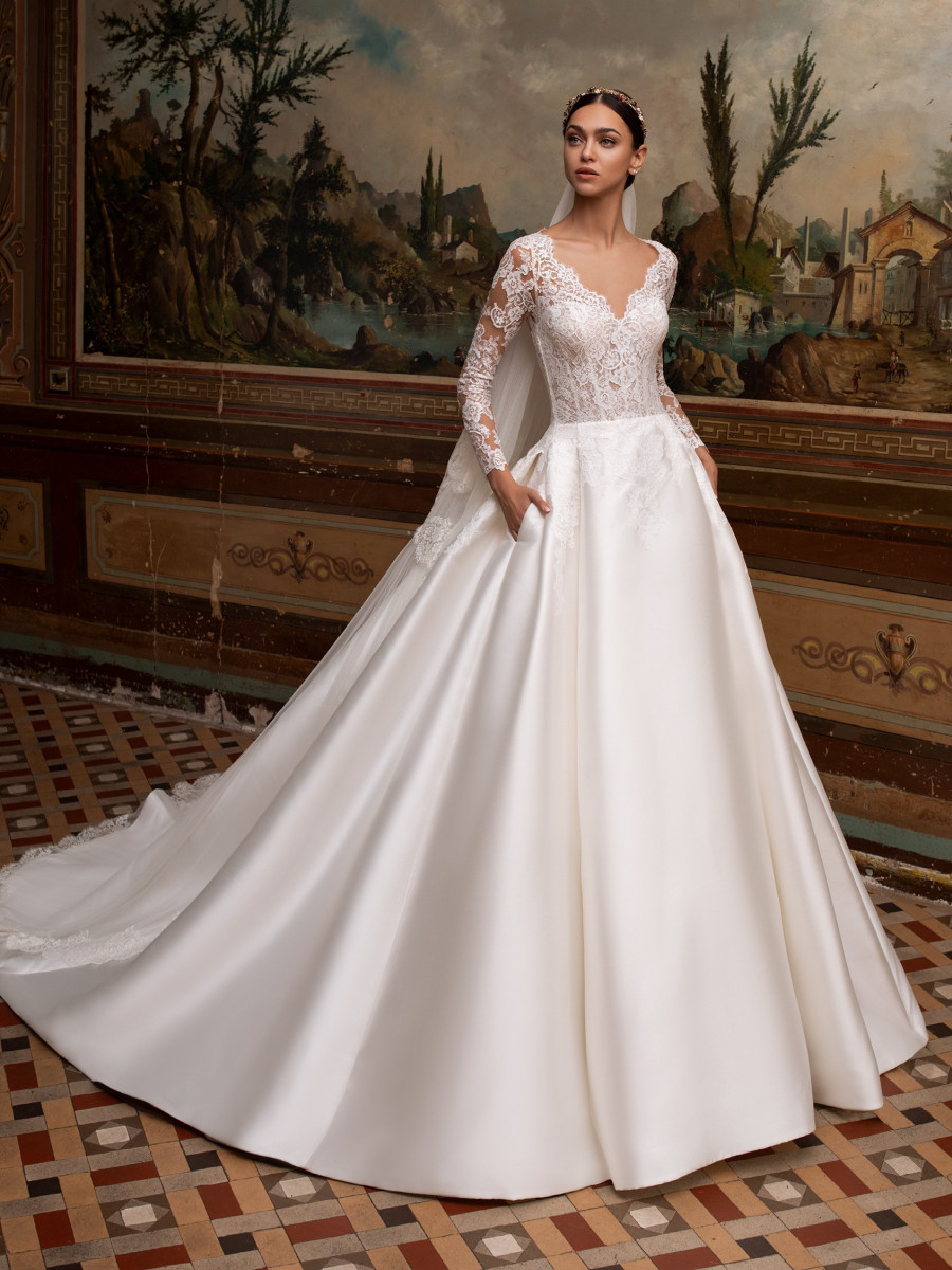 A Pronovias romantic lace and silk ball gown wedding dress with pockets and long sleeves