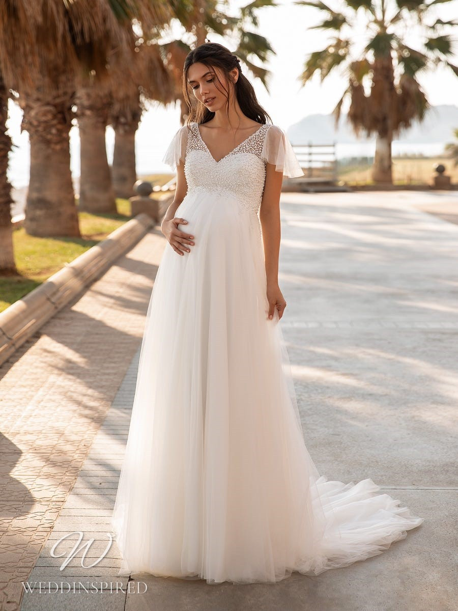 A Pronovias 2021 tulle maternity A-line wedding dress with short sleeves