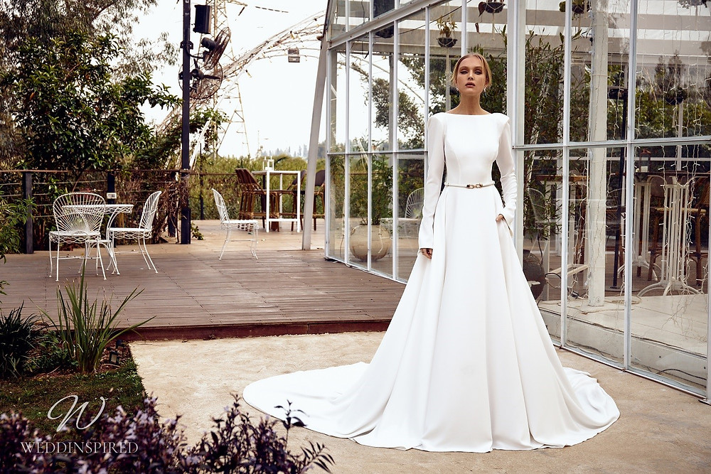 A Julie Vino 2021 simple silk A-line wedding dress with long sleeves, a low back and a train