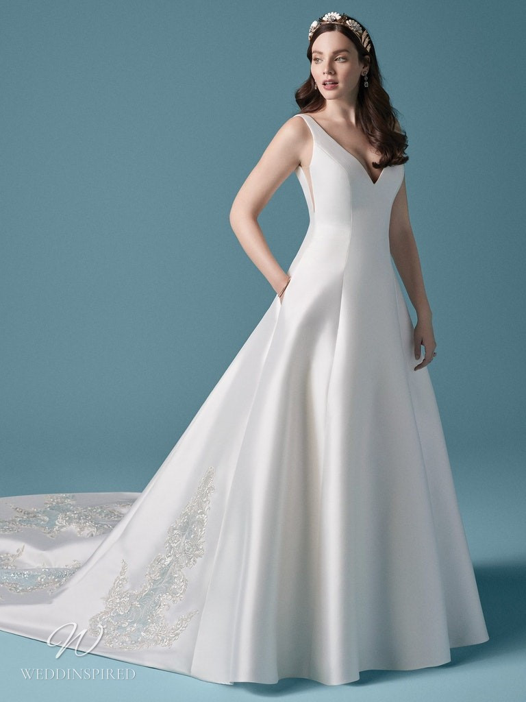 A Maggie Sottero 2021 simple silk ball gown wedding dress with a train
