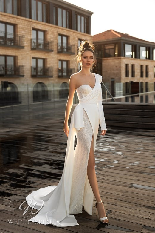 An Ida Torez 2021 one shoulder sparkle and crepe sexy mermaid wedding dress with a high slit