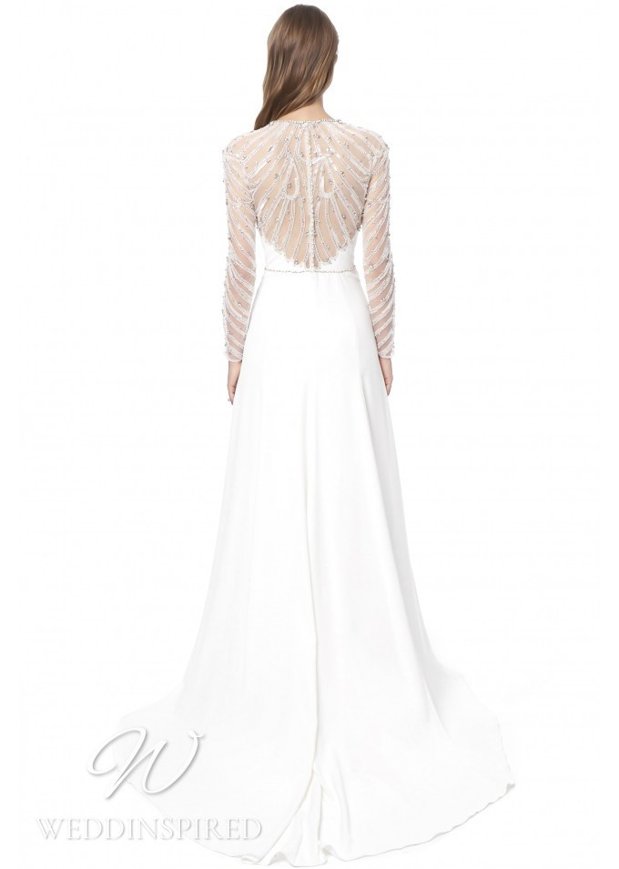 A Jenny Packham 2021 sparkly sheath wedding dress with long sleeves