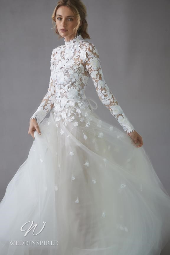 An Oscar de la Renta 2022 lace and tulle A-line wedding dress with long sleeves