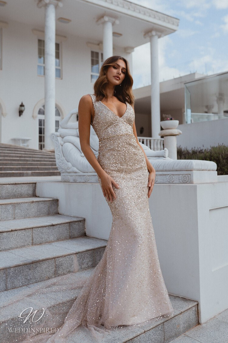 An Anna Campbell 2020 gold and blush v neck mermaid wedding dress with crystals and sparkles