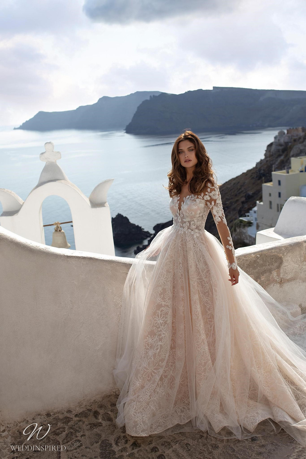A Ricca Sposa romantic blush lace and tulle ball gown wedding dress with long sleeves