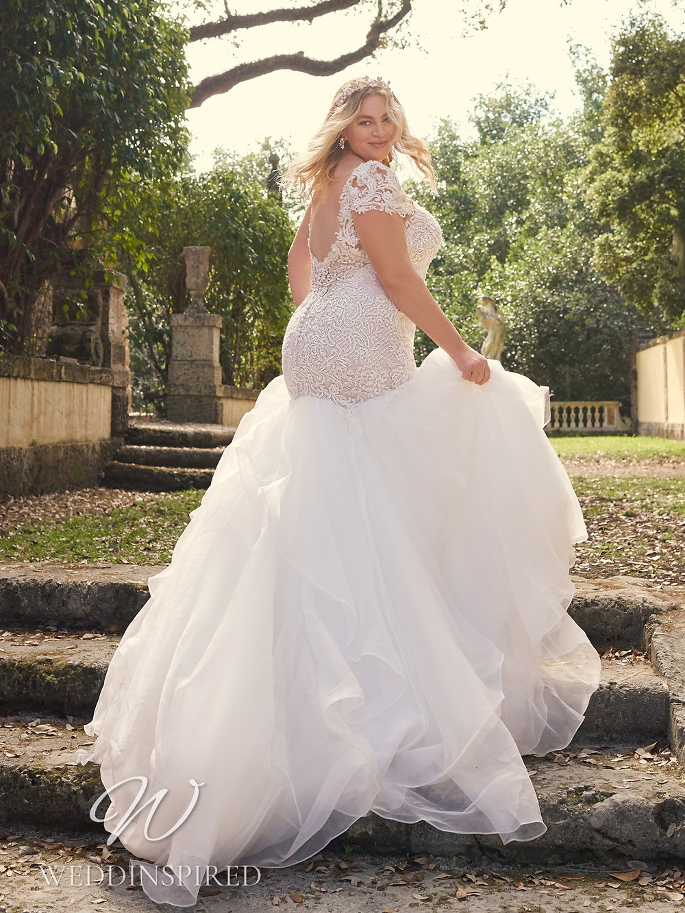 A Maggie Sottero 2021 plus size lace and tulle mermaid wedding dress