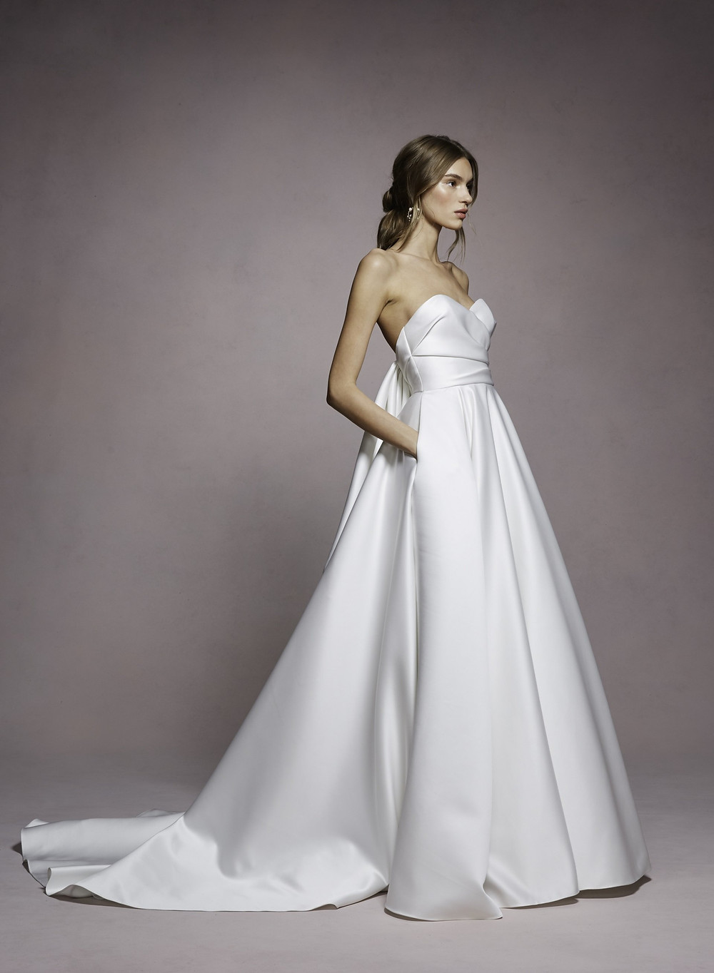 A Marchesa simple strapless silk ball gown wedding dress with pockets and a sweetheart neckline