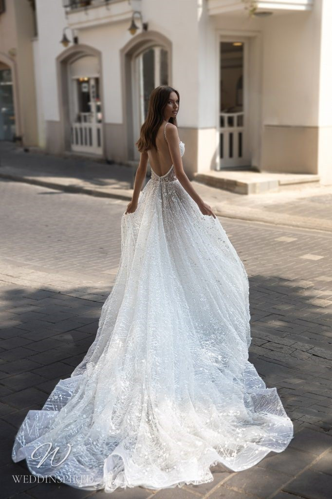 An Eden Aharon 2020 lace and tulle A-line wedding dress with a bustier top, straps and a low back