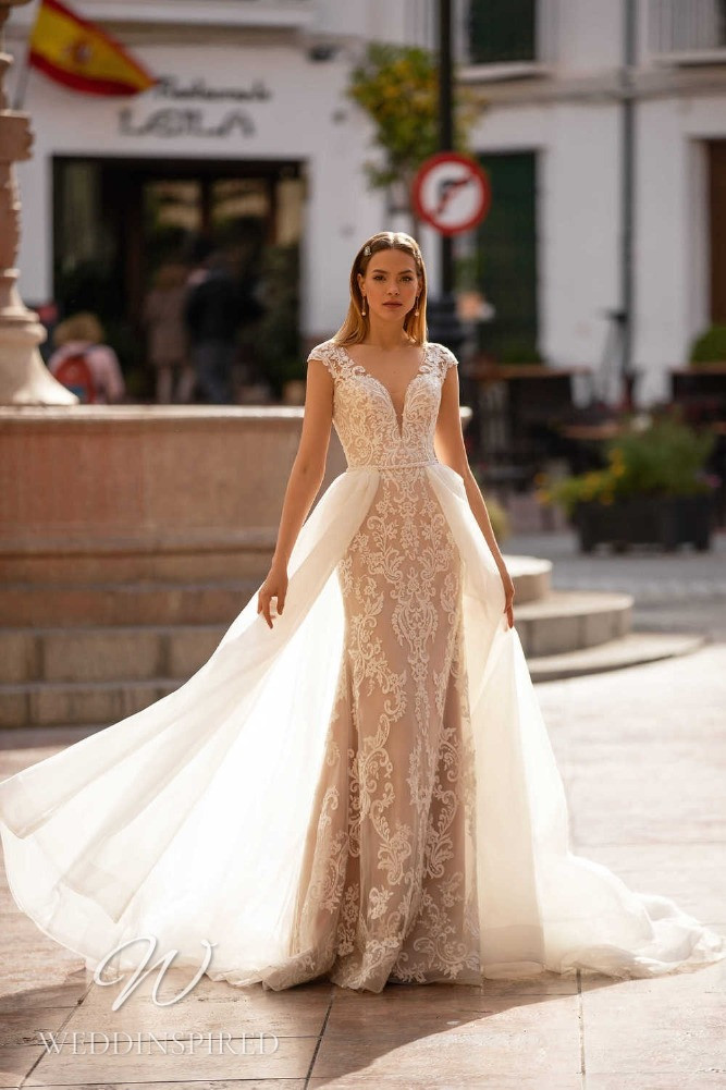 A Nora Naviano 2021 lace mermaid wedding dress with a tulle detachable skirt