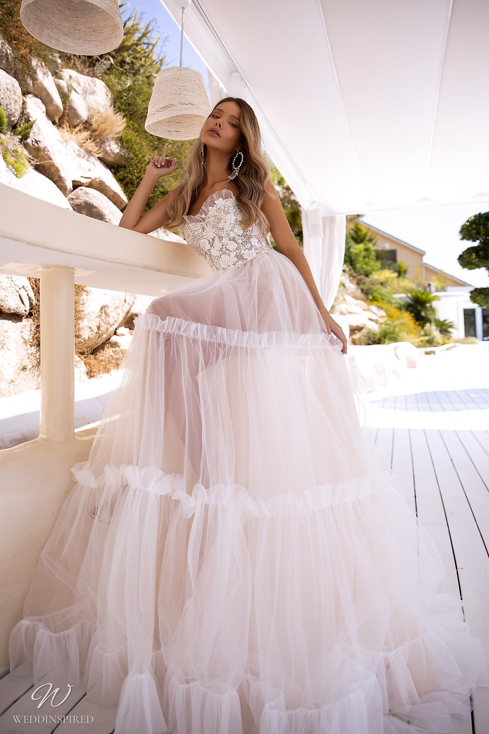 A Tina Valerdi strapless tulle A-line wedding dress with lace and a ruffle skirt