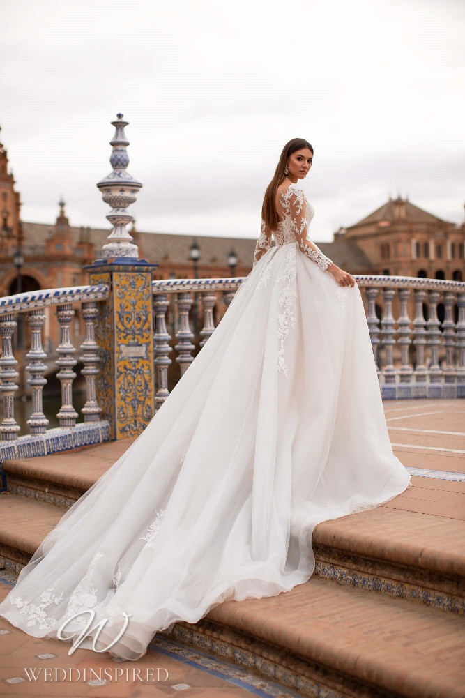 A Nora Naviano 2021 lace and tulle princess wedding dress with long sleeves