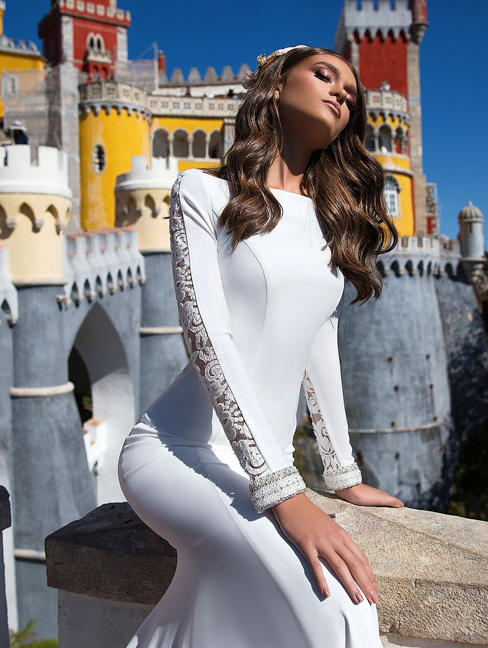 A Milla Nova simple mermaid wedding dress with long sleeves and lace inserts