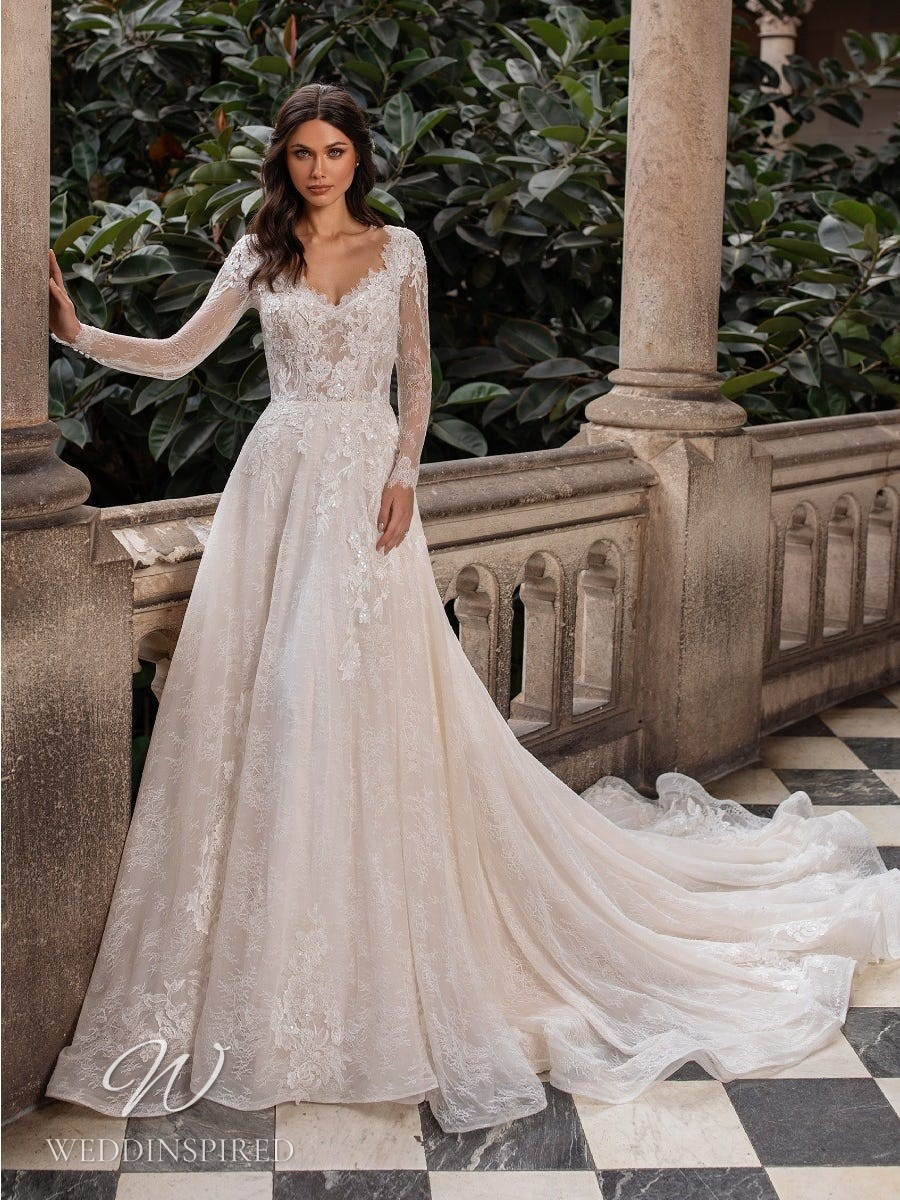 An Ashley Graham x Pronovias 2021 lace A-line wedding dress with long sleeves and a v neck