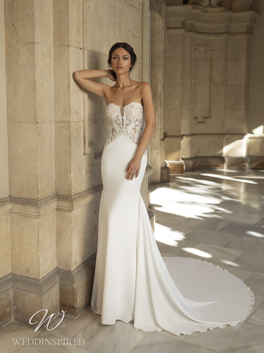 A Pronovias Privée 2021 strapless lace and crepe mermaid wedding dress with a train