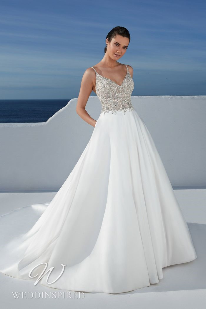 A Justin Alexander 2021 satin A-line wedding dress with beading