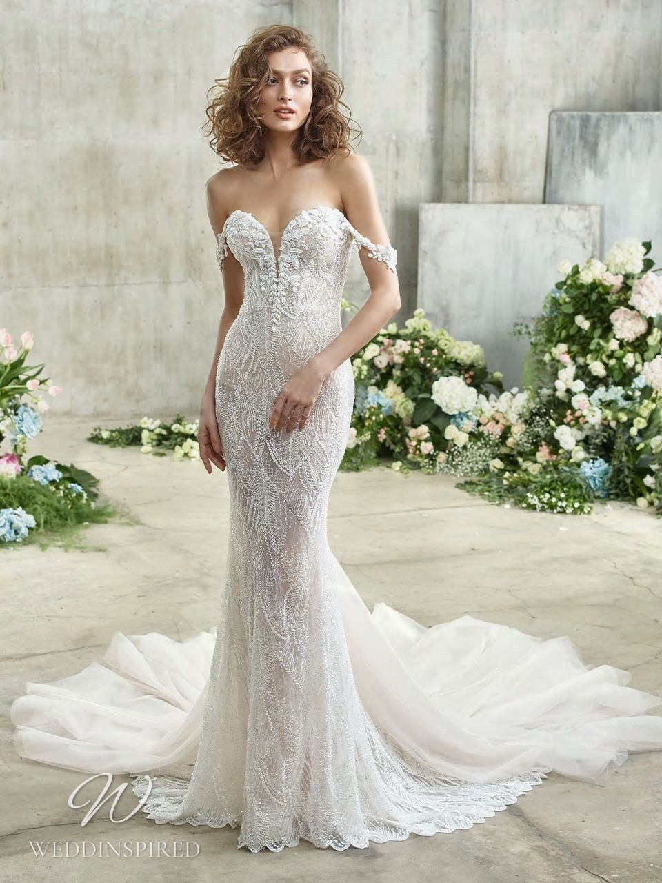 A Badgley Mischka mermaid off the shoulder lace wedding dress with a sweetheart neckline and a train