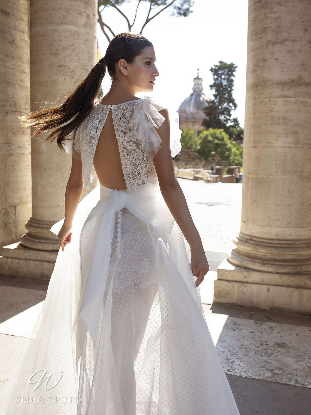 A Pinella Passaro lace and tulle A-line wedding dress with a bow