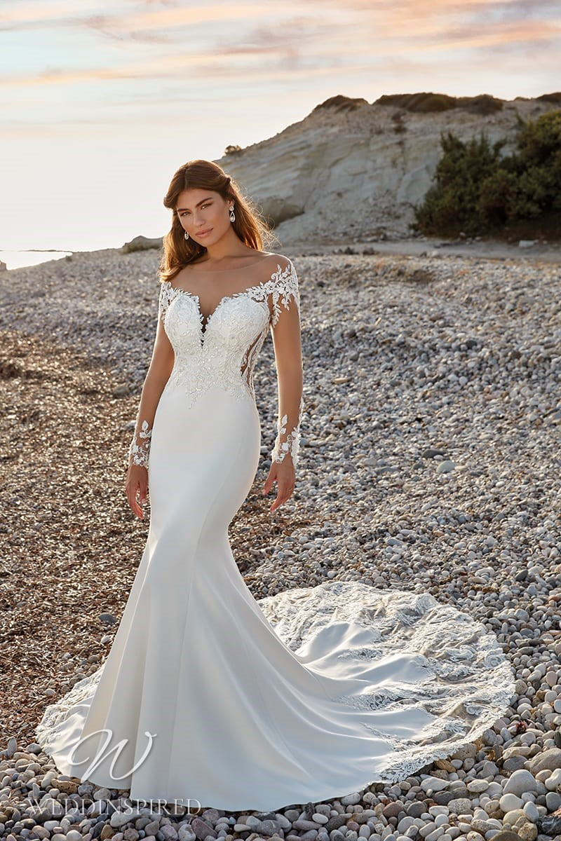 An Eddy K 2022 lace and satin off the shoulder mermaid wedding dress