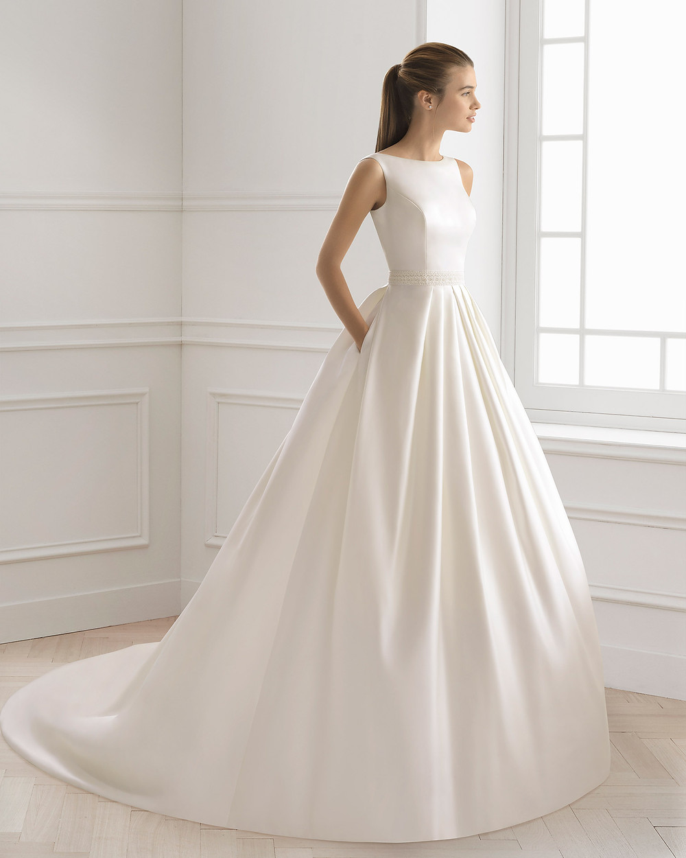 An Aire Barcelona 2020 simple silk ball gown wedding dress with pockets