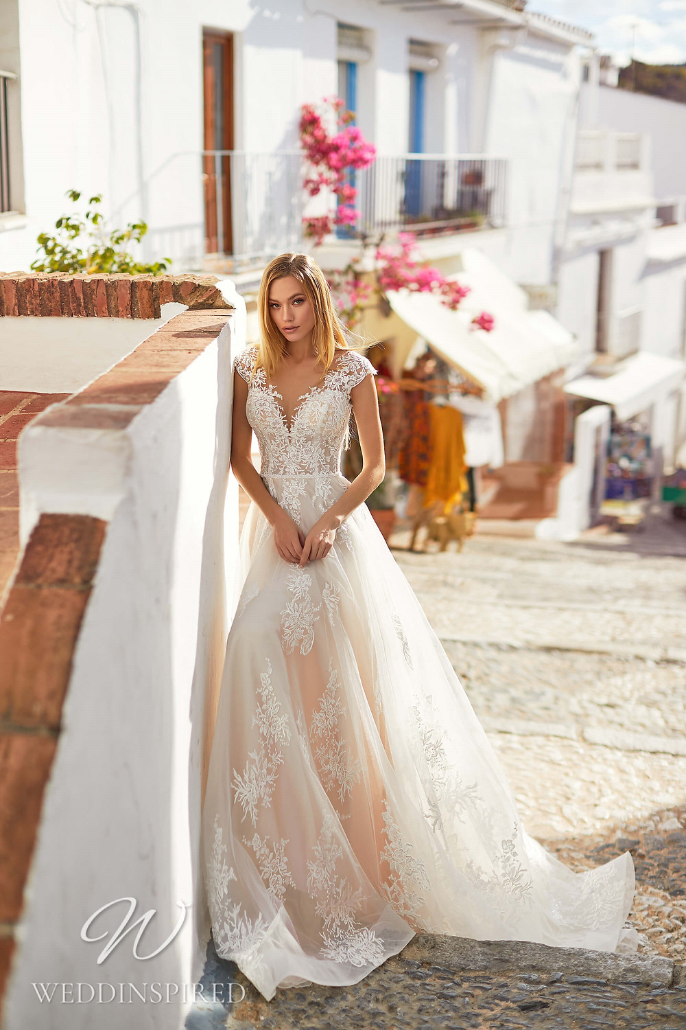 An Essential by Lussano 2021 lace and tulle A-line wedding dress with cap sleeves