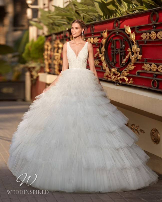 An Aire Barcelona 2021 tulle ball gown wedding dress with a layered ruffle skirt