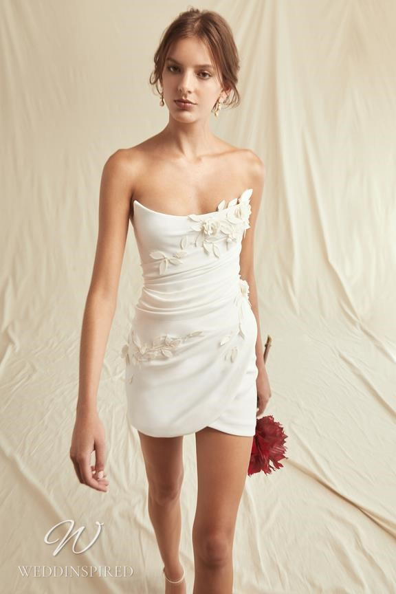 A Oscar de la Renta 2021 short strapless wedding dress