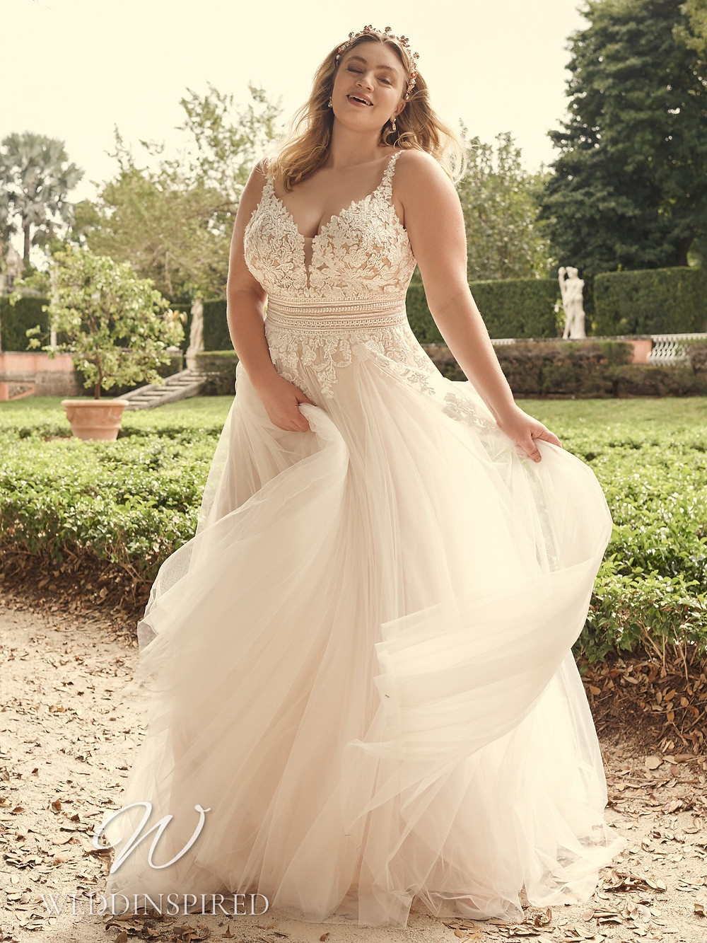 A Maggie Sottero 2021 plus size lace and tulle A-line wedding dress