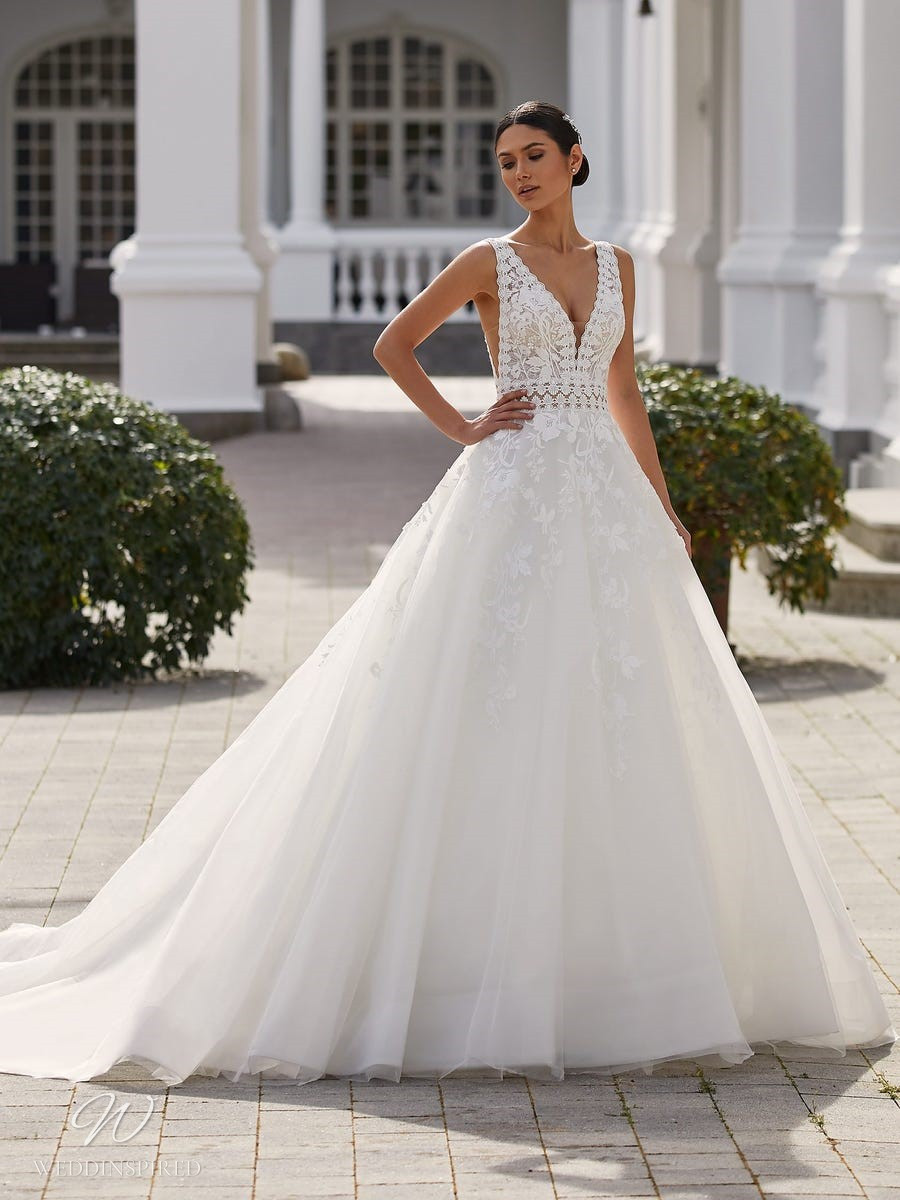 A Pronovias 2021 lace and tulle ball gown wedding dress with a v neckline and straps