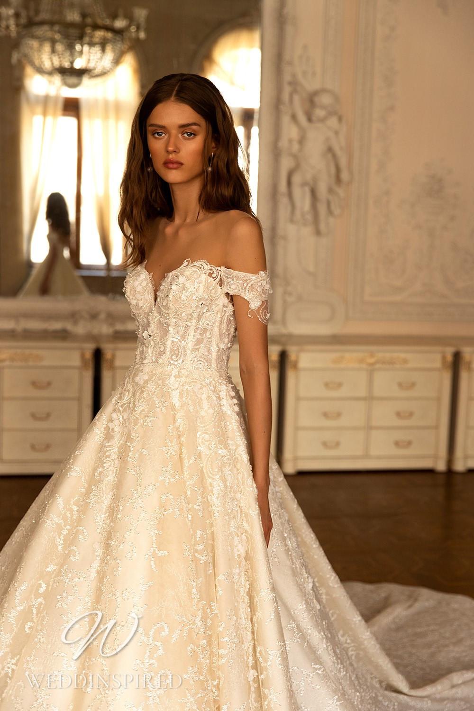 A WONÁ Concept 2021 blush lace off the shoulder princess wedding dress